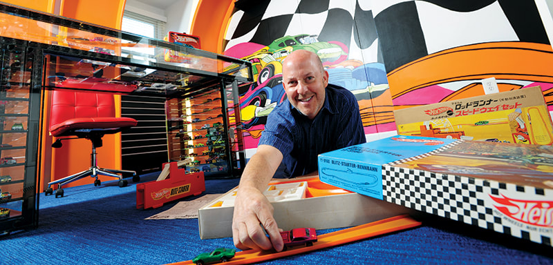 Bruce Pascal shows off his Hot Wheels collection, which includes about 3,000 toy cars, in his Potomac home. Photo by Michael Ventura